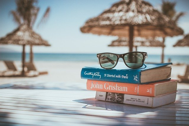image of a book and a beach